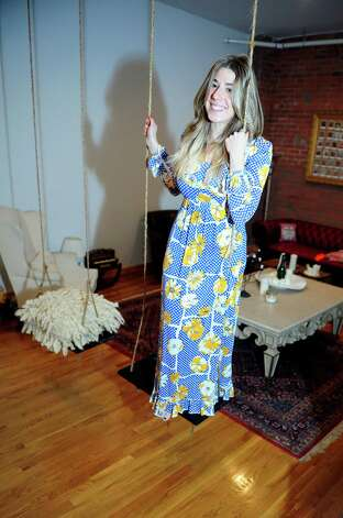 Avid thrift shop hunter Maddie Rhodes at home in Bridgeport, Conn.  Rhodes is wearing a floral dress purchased at Stratfort Antiques for $45. Photo: Autumn Driscoll