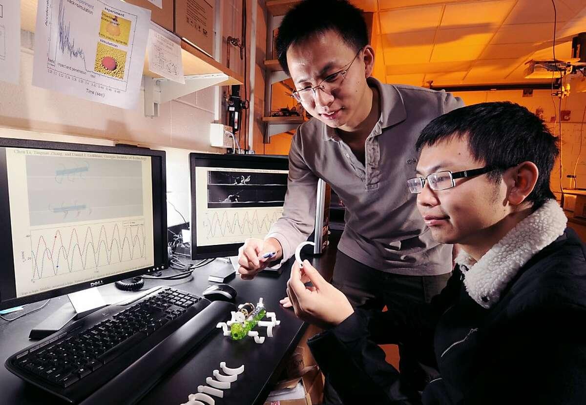 Terradynamics of legged locomotion on granular media. Left to right: Chen Li and Tingnan Zhang.