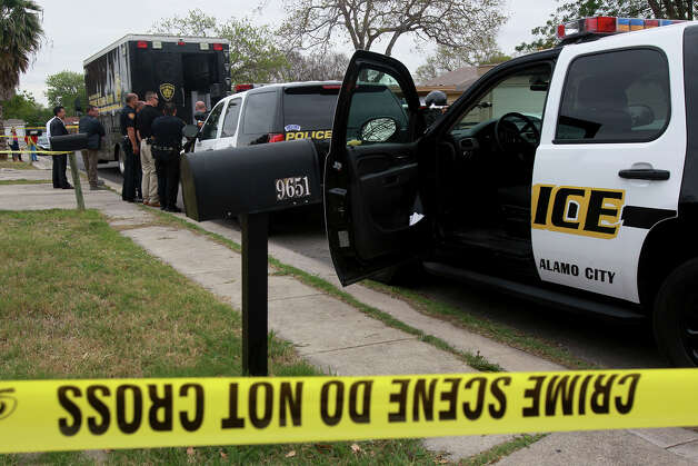 San Antonio police investigate the scene of a home Thursday March 21, 2013 on the 9600 block of Vale where three bodies were found by police after a request for a welfare check was made. Inside, officers found the body of a woman on a bed, and the body of a younger man on the floor of another bedroom. A second man, believed to be in his late 70s, was found in a living room chair. He apparently killed the other man and the woman using a .22 caliber rifle before turning the weapon on himself, San Antonio police Chief William McManus said. Photo: JOHN DAVENPORT, SAN ANTONIO EXPRESS-NEWS / ©San Antonio Express-News/Photo may be sold to the public