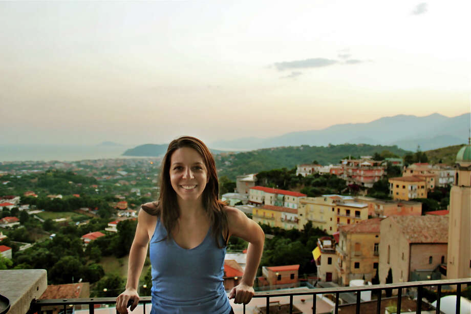 Mickela Mallozzi, who grew up in Stamford and now lives in New York City, is host and creator of the travel/dance web series, Bare Feet(TM). Her travels have taken her to Minturno, Italy, seen behind her in this photo, which is her family's hometown and a sister city to Stamford, Conn. She will soon  begin offering tours -- one in Spring 2013 and Summer 2013 -- that allow participants to learn about place through dance and music. Contributed photo/Benedetto Digirolamo Photo: Contributed Photo