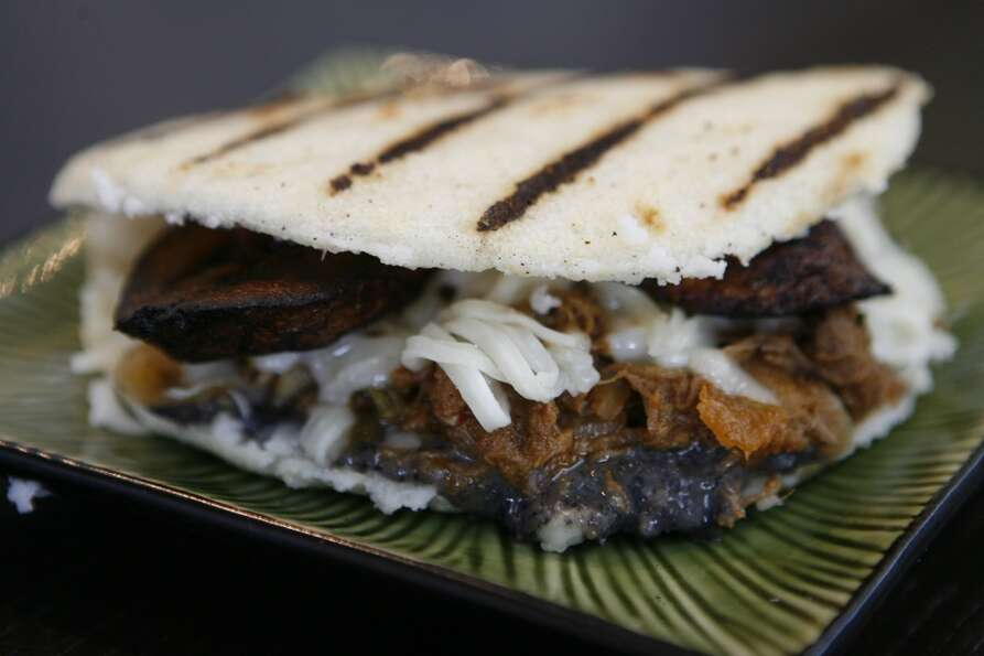 Arepa: Shredded Beef Pabellón with sweet plantains, black bean spread, queso fresco