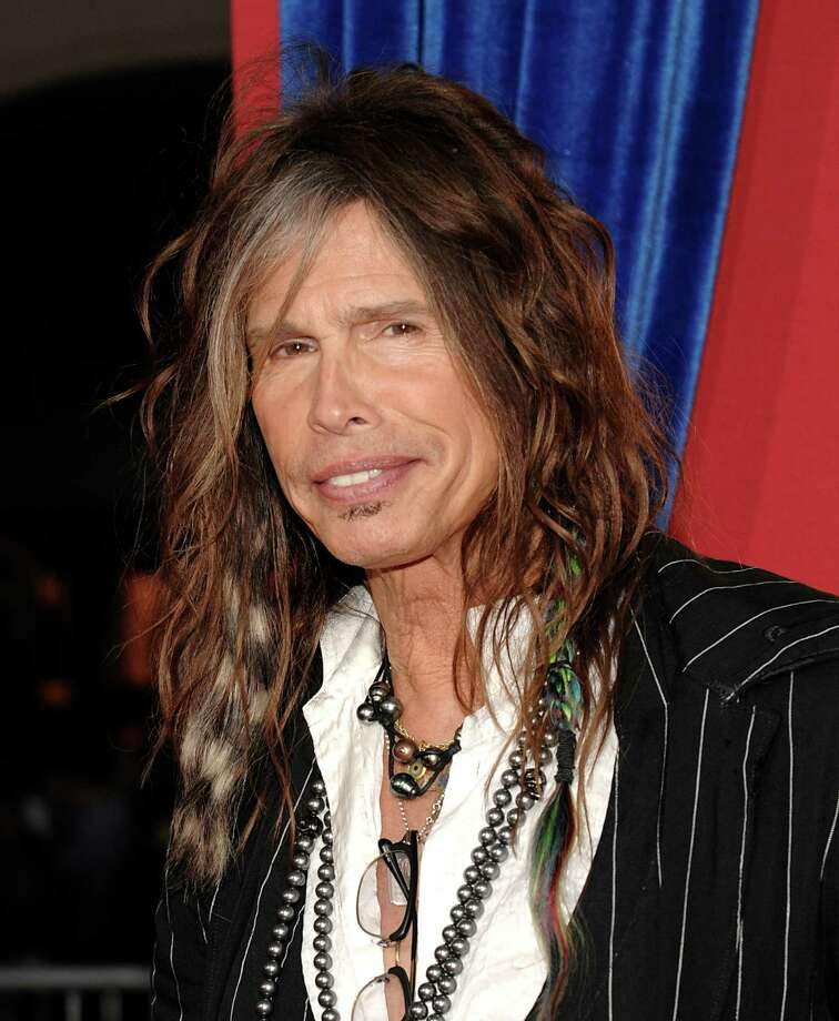 "FILE - This March 11, 2013 file photo shows singer Steven Tyler arriving at the world premiere of the feature film ""The Incredible Burt Wonderstone"" in Los Angeles. The future is looking bleak for the Hawaii celebrity privacy bill known as the Steven Tyler Act.  The proposal pushed by the Aerosmith lead singer is missing deadlines in the state House and key lawmakers say they won't push it through. The bill to prevent unwanted photos and video people in their private moments sailed through the state Senate earlier this month, after Tyler testified in person at a committee hearing in February.  (Photo by Dan Steinberg/Invision/AP, file) Photo: Dan Steinberg"
