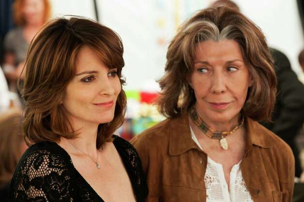 "This publicity photo released by Focus Features shows Tina Fey, left, who stars as Portia and Lily Tomlin who stars as Susannah, in a scene from the comedy/drama film, ""Admission,"" directed by Paul Weitz. The movie is a Focus Features release opening March 22.  (AP Photo/Focus Features, David Lee) Photo: David Lee"