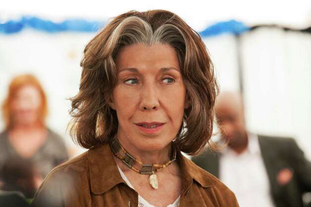"This publicity photo released by Focus Features shows Lily Tomlin who stars as Susannah in a scene from the comedy/drama film, ""Admission,"" directed by Paul Weitz. The movie is a Focus Features release opening March 22, 2013.  (AP Photo/Focus Features, David Lee) Photo: David Lee"