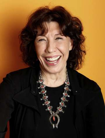 "In this Friday, March 15, 2013 photo, actress Lily Tomlin poses for a portrait at the Four Seasons Hotel, in Los Angeles. For Tomlin, 70 is the new 30, at least momentarily. In the Paul Weitz directed comedy ""Admission,"" opening March 22, Tomlin plays the young-at-heart feminist mother of a university admissions officer, portrayed by Tina Fey.  (Photo by Matt Sayles/Invision/AP) Photo: Matt Sayles"