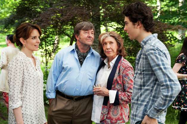 "This publicity photo released by Focus Features shows, from left, Tina Fey, who stars as Portia, Olek Krupa as Professor Polokov, Lily Tomlin stars as Susannah and Nat Wolff as Jeremiah, in a scene from the film, ""Admission,"" directed by Paul Weitz. The movie is a Focus Features release opening March 22. (AP Photo/Focus Features, David Lee) Photo: David Lee"
