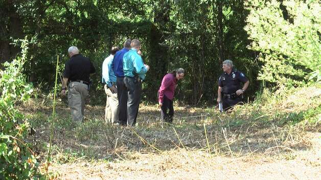 Authorities at the scene of the discovery of the skeletal remains of Layron Carey in Conroe. | Scott J. Engle of Montgomery County Police Reporter Photo: .