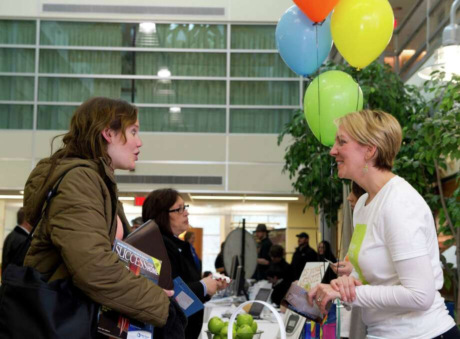 Emily Derr of the Westport Chamber of Commerce, left, speaks with Amy DeLardi of Infinite Web Design in Fairfield during the annual multi-chamber business expo at Norwalk Community College in Norwalk, Conn., on Thursday, March 21, 2013. Photo: Lindsay Perry / Stamford Advocate