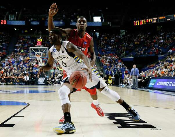 LEXINGTON, KY - MARCH 21: Jamil Wilson #0 of the Marquette Golden Eagles drives against De'Mon Brooks #24 of the Davidson Wildcats in the first half during the second round of the 2013 NCAA Men's Basketball Tournament at the Rupp Arena on March 21, 2013 in Lexington, Kentucky. Photo: Kevin C. Cox, Getty Images / 2013 Getty Images