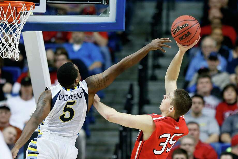 LEXINGTON, KY - MARCH 21: Chris Czerapowicz #35 of the Davidson Wildcats shoots against Junior Cadougan #5 of the Marquette Golden Eagles in the first half during the second round of the 2013 NCAA Men's Basketball Tournament at the Rupp Arena on March 21, 2013 in Lexington, Kentucky. Photo: Kevin C. Cox, Getty Images / 2013 Getty Images
