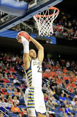 Marquette Golden Eagles' Trent Lockett (22) dunks against the Davidson Wildcats' in the first half of the men's NCAA basketball tournament at Rupp Arena in Lexington, Kentucky, Thursday, March 21, 2013. (Pablo Alcala/Lexington Herald-Leader/MCT) Photo: Pablo Alcala, McClatchy-Tribune News Service / Lexington Herald-Leader
