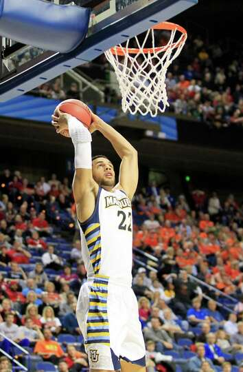 Marquette Golden Eagles' Trent Lockett (22) dunks against the Davidson Wildcats' in the first half o
