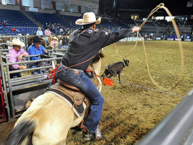 A cowboy comes of the shoot at the YMBL Harold Engstrom Memorial Special Kids Rodeo at Ford Park on Thursday. The YMBL hosts the event allowing hundreds of mental and/or physically challenged students to attend.  Photo taken Thursday, March 21, 2013 Guiseppe Barranco/The Enterprise Photo: Guiseppe Barranco, STAFF PHOTOGRAPHER / The Beaumont Enterprise