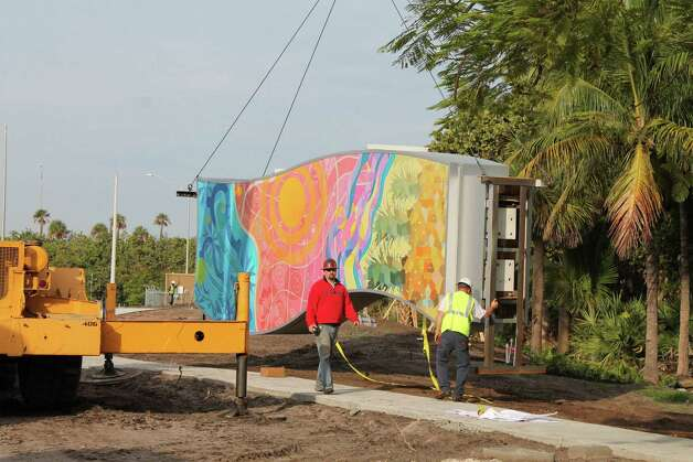 Workers install one of six colorful columns of Michelle Newman's public art gateway to Delray Beach, Fla. Photo: Mark Randall / South Florida Sun Sentinel