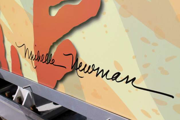 "Newman's signature is on one of the panels she designed for the public art ""gateway."""