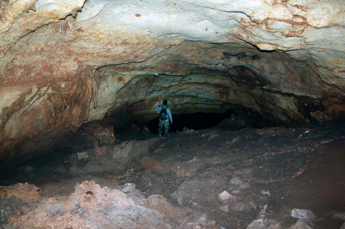 An unidentified person walks into Rock Dove Cave in this picture provided by the informal group Friends of Rock Dove Cave.