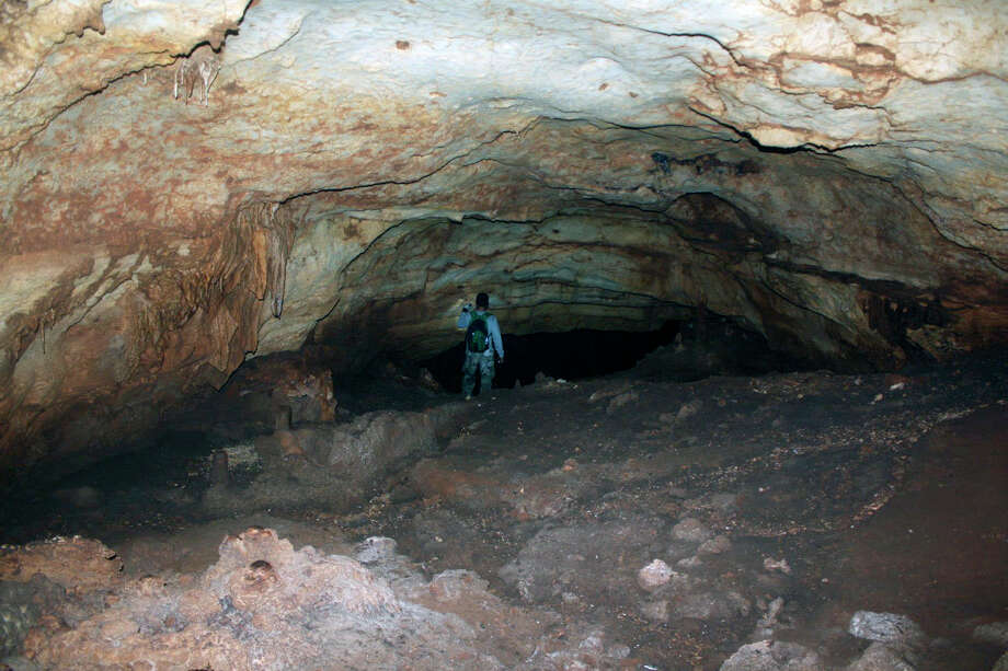An unidentified person walks into Rock Dove Cave in this picture provided by the informal group Friends of Rock Dove Cave. Photo: COURTESY PHOTO, FRIENDS OF ROCK DOVE CAVE / COURTESY OF THE FRIENDS OF ROCK DOVE CAVE