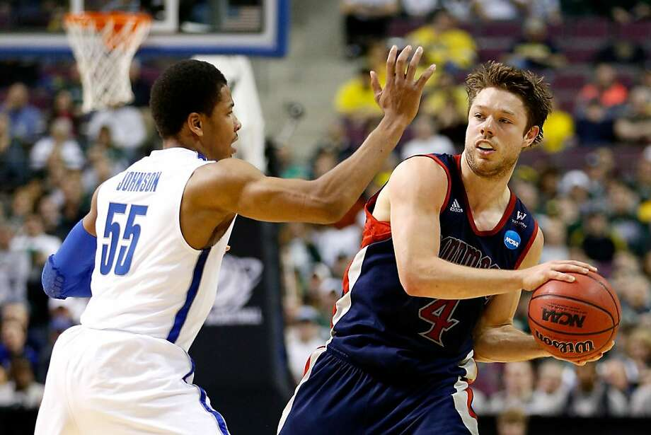 AUBURN HILLS, MI - MARCH 21:  Matthew Dellavedova #4 of the St. Mary's Gaels looks to pass the ball against Geron Johnson #55 of the Memphis Tigers during the second round of the 2013 NCAA Men's Basketball Tournament at at The Palace of Auburn Hills on March 21, 2013 in Auburn Hills, Michigan.  (Photo by Gregory Shamus/Getty Images) Photo: Gregory Shamus, Getty Images