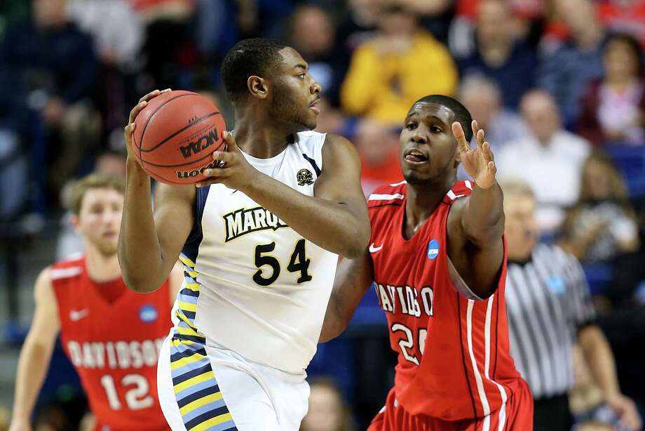 Marquette 59, Davidson 58LEXINGTON, KY - MARCH 21:  Davante Gardner #54 of the Marquette Golden Eagles looks to pass against De'Mon Brooks #24 of the Davidson Wildcats in the first half during the second round of the 2013 NCAA Men's Basketball Tournament at the Rupp Arena on March 21, 2013 in Lexington, Kentucky. Photo: Andy Lyons, Getty Images / 2013 Getty Images