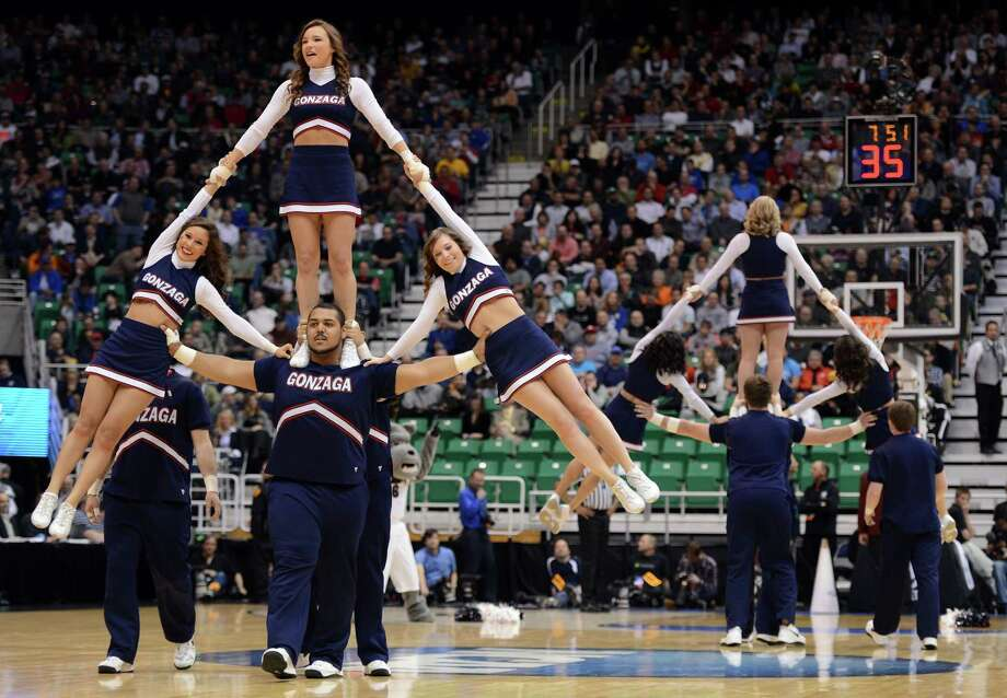 The Gonzaga Bulldogs cheerleaders perform in the first half during a break in the game against the Southern University. Photo: Harry How, Getty Images / 2013 Getty Images