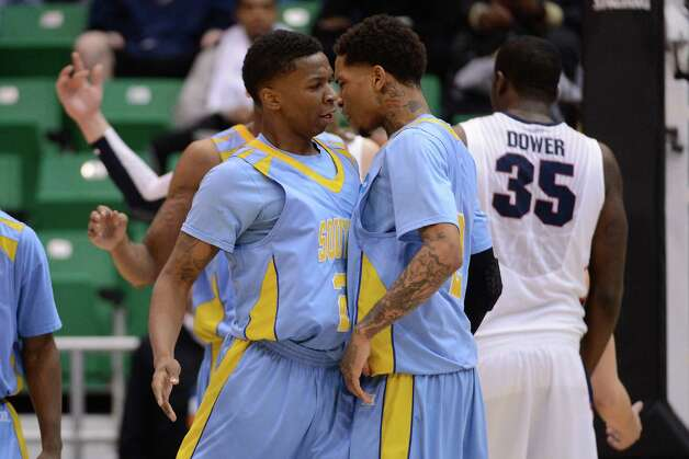 SALT LAKE CITY, UT - MARCH 21:  YonDarius Johnson #23 and Derick Beltran #2 of the Southern University Jaguars celebrate in the first half while taking on the Gonzaga Bulldogs during the second round of the 2013 NCAA Men's Basketball Tournament at EnergySolutions Arena on March 21, 2013 in Salt Lake City, Utah. Photo: Harry How, Getty Images / 2013 Getty Images