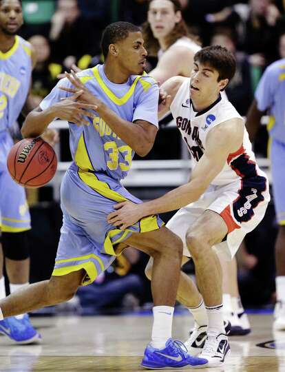 Gonzaga's Mike Hart (30) knocks the ball from Southern University's Malcolm Miller (33) in the first