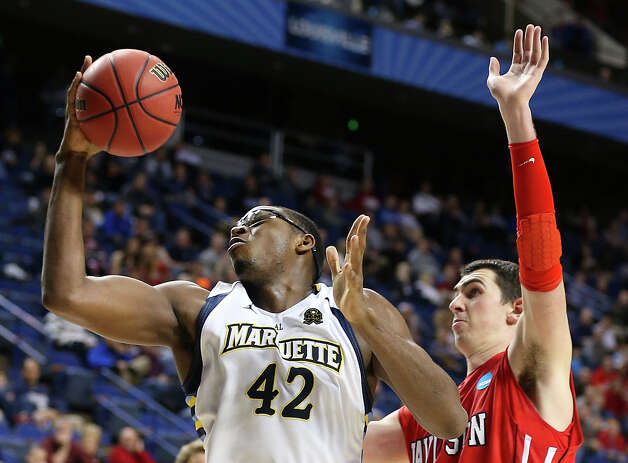 Chris Otule #42 of the Marquette Golden Eagles shoots against JP Kuhlman #5 of the Davidson Wildcats in the second half. Photo: Andy Lyons, Getty Images / 2013 Getty Images