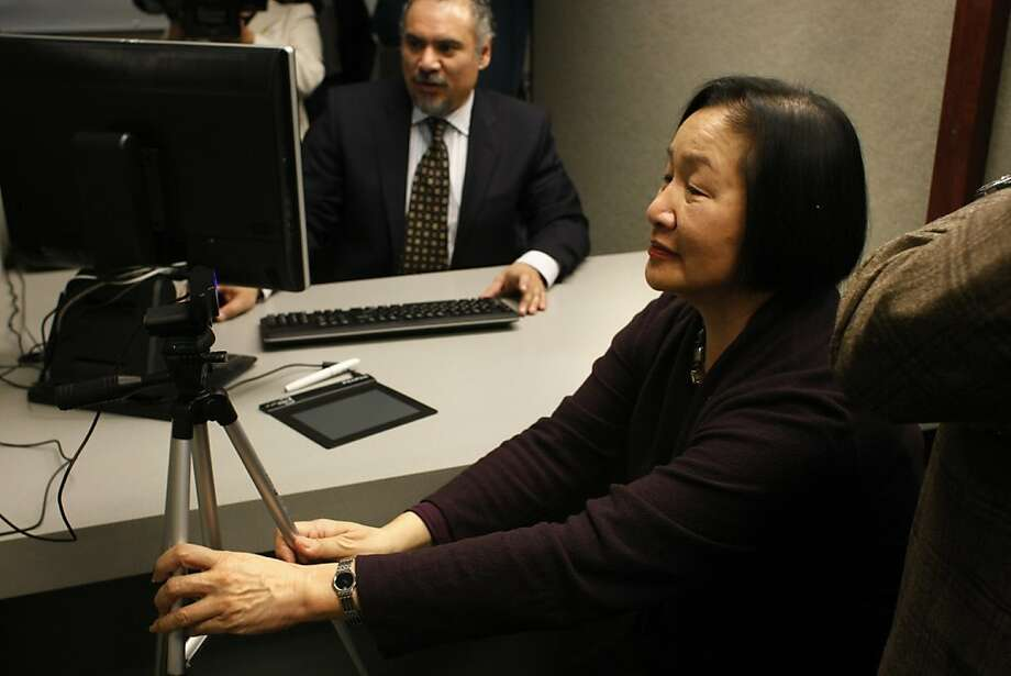 "Mayor Jean Quan's spokesman says the city is ""breaking new ground on how we treat immigrant populations,"" explaining the decision to add a debit card. Photo: James Tensuan, The Chronicle"