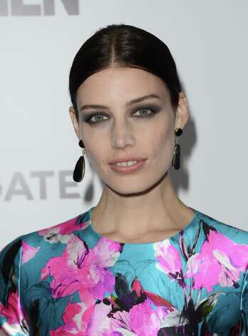 Actress Jessica Pare arrive at the Premiere of AMC's 'Mad Men' Season 6 at DGA Theater on March 20, 2013 in Los Angeles, California. Photo: Jason Merritt, Getty Images / 2013 Getty Images