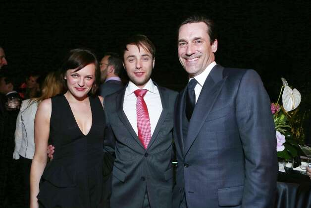 From left, Elisabeth Moss, Vincent Kartheiser and Jon Hamm attend the after party for the AMC Season 6 Premiere of Mad Men, on Wednesday, March, 20, 2013 in Los Angeles. (Photo by Alexandra Wyman/Invision for AMC/AP Images) Photo: Alexandra Wyman, Associated Press / Invision