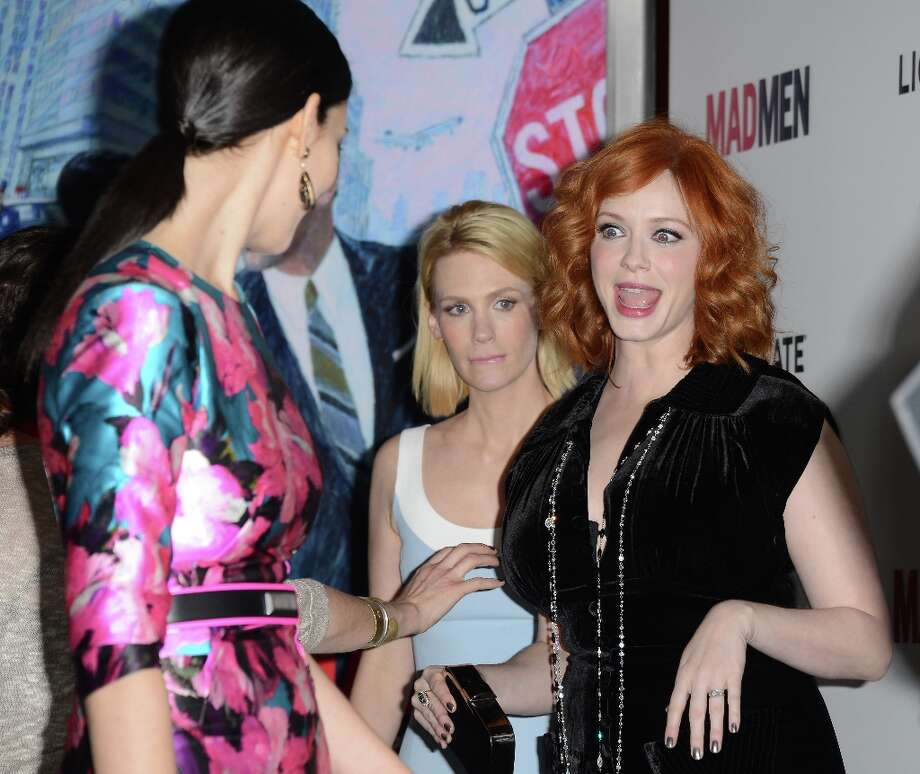Actresses (L-R) January Jones and Christina Hendricks arrive at the Premiere of AMC's 'Mad Men' Season 6 at DGA Theater on March 20, 2013 in Los Angeles, California. Photo: Jason Merritt, Getty Images / 2013 Getty Images