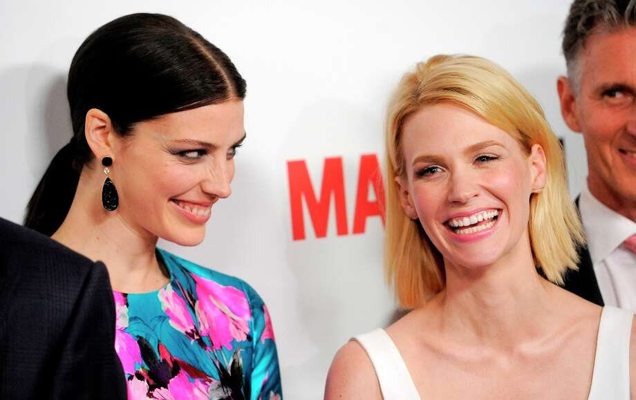Jessica Pare, left, and January Jones, cast members in Mad Men, pose together at the season six premiere of the drama series at the Directors Guild of America on Wednesday, March 20, 2013 in Los Angeles. (Photo by Chris Pizzello/Invision/AP) Photo: Chris Pizzello, Associated Press / Invision