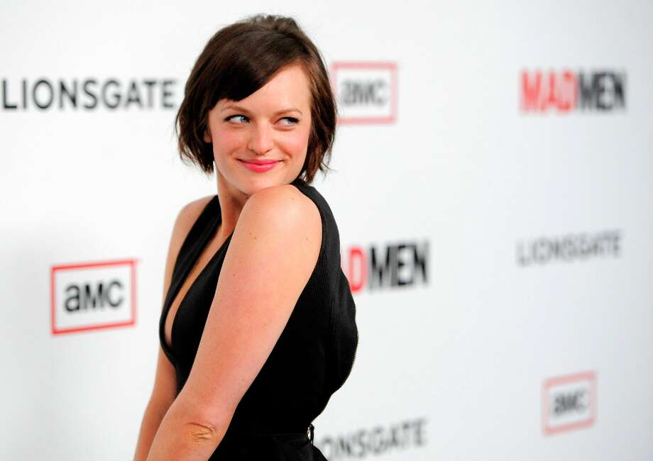 Elisabeth Moss, a cast member in Mad Men, turns back for photographers at the season six premiere of the drama series at the Directors Guild of America on Wednesday, March 20, 2013 in Los Angeles. (Photo by Chris Pizzello/Invision/AP) Photo: Chris Pizzello, Associated Press / Invision