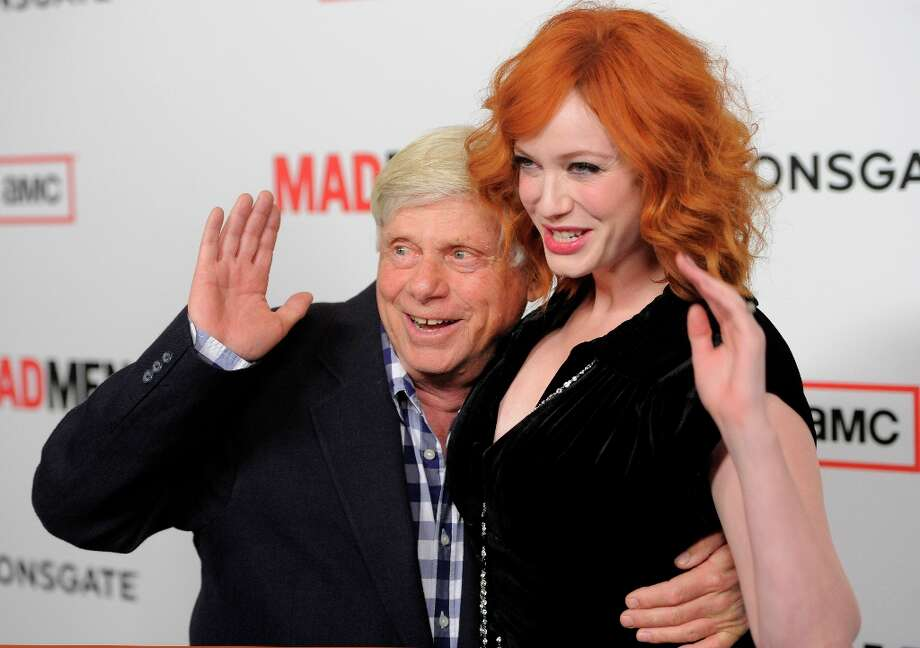 Robert Morse, left, and Christina Hendricks, cast members in Mad Men, pose together at the season six premiere of the drama series at the Directors Guild of America on Wednesday, March 20, 2013 in Los Angeles. (Photo by Chris Pizzello/Invision/AP) Photo: Chris Pizzello, Associated Press / Invision