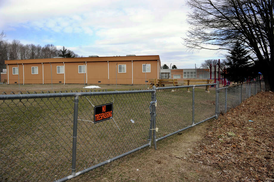 The Sandy Hook Elementary School is viewed from the playground area, Friday, March 15, 2013. Photo: Carol Kaliff / The News-Times