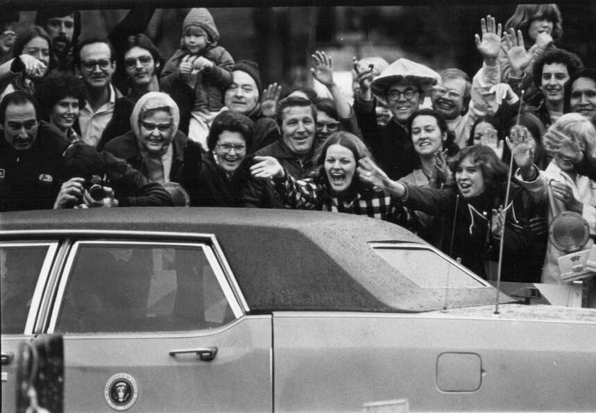 People wave to President Jimmy Carter in Denver on May 3, 1978.