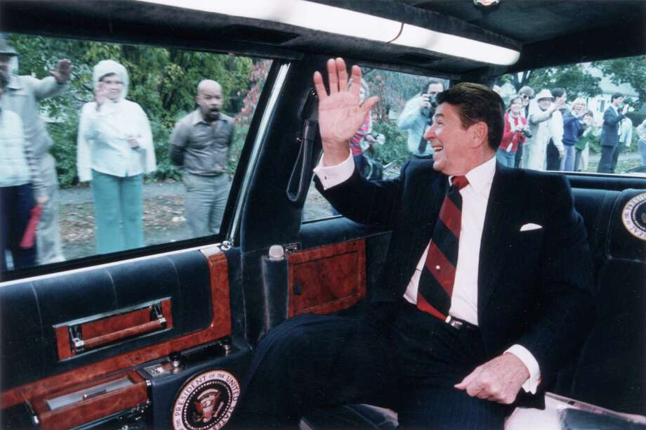President Ronald Reagan waves from the back of his limousine in Fairfield, Conn., on Oct. 26, 1984. Photo: Ronald Reagan Library, Getty Images / Archive Photos