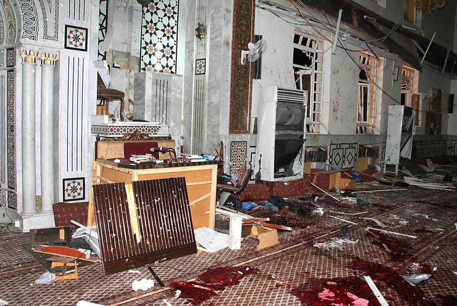 A bomb blast ripped through Damascus' Eman Mosque, killing at least 42 and injuring dozens, in an assassination of an 84-year-old cleric known to most Syrians as a religious scholar. Photo: Hopd, Associated Press
