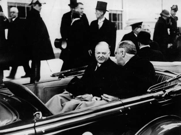 Franklin D. Roosevelt (right) leaves the White House for the Capitol on his inauguration day, March 16, 1933, with outgoing President Herbert Hoover beside him. Photo: Topical Press Agency, Getty Images / Hulton Archive