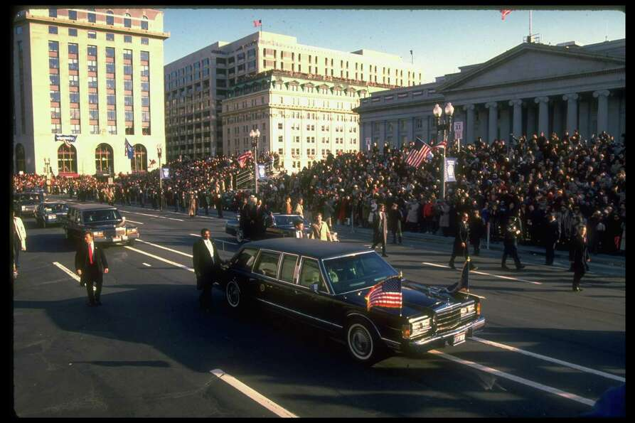 President George H.W. Bush rides in his inaugural parade on Jan. 20, 1989.