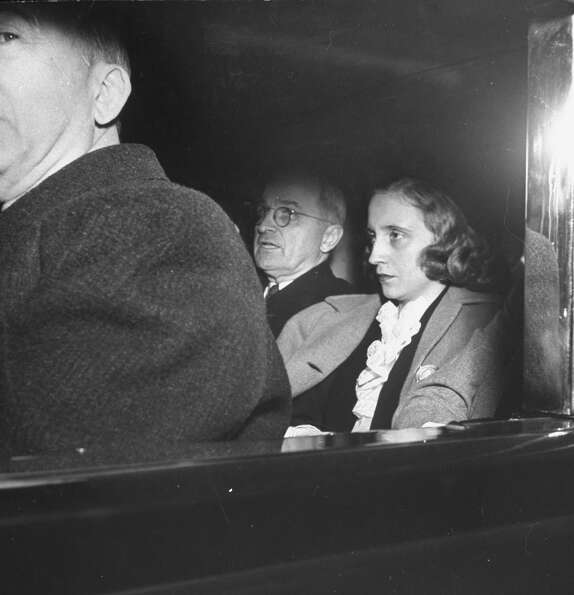 President Harry S Truman and daughter Margaret ride to the funeral for Franklin D. Roosevelt, who di