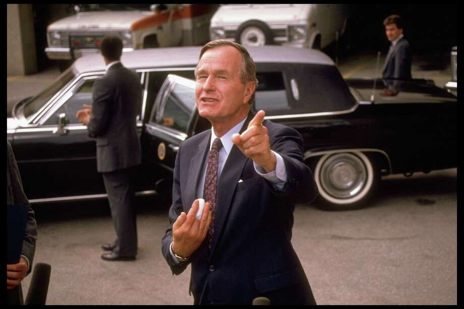 President Bush, sporting a bandaged finger following surgery, speaks about the situation in Panama on Oct. 6, 1989. The United States invaded Panama and ousted dictator Manuel Noriega in December 1989. Photo: Dirck Halstead, Time & Life Pictures/Getty Image / Dirck Halstead