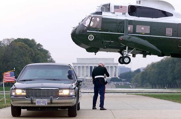 The presidential limousine and a Marine Guard await the arrival of President Bill Clinton aboard Marine One on Nov. 10, 1999, in Washington, D.C. Photo: TIM SLOAN, AFP/Getty Images / AFP
