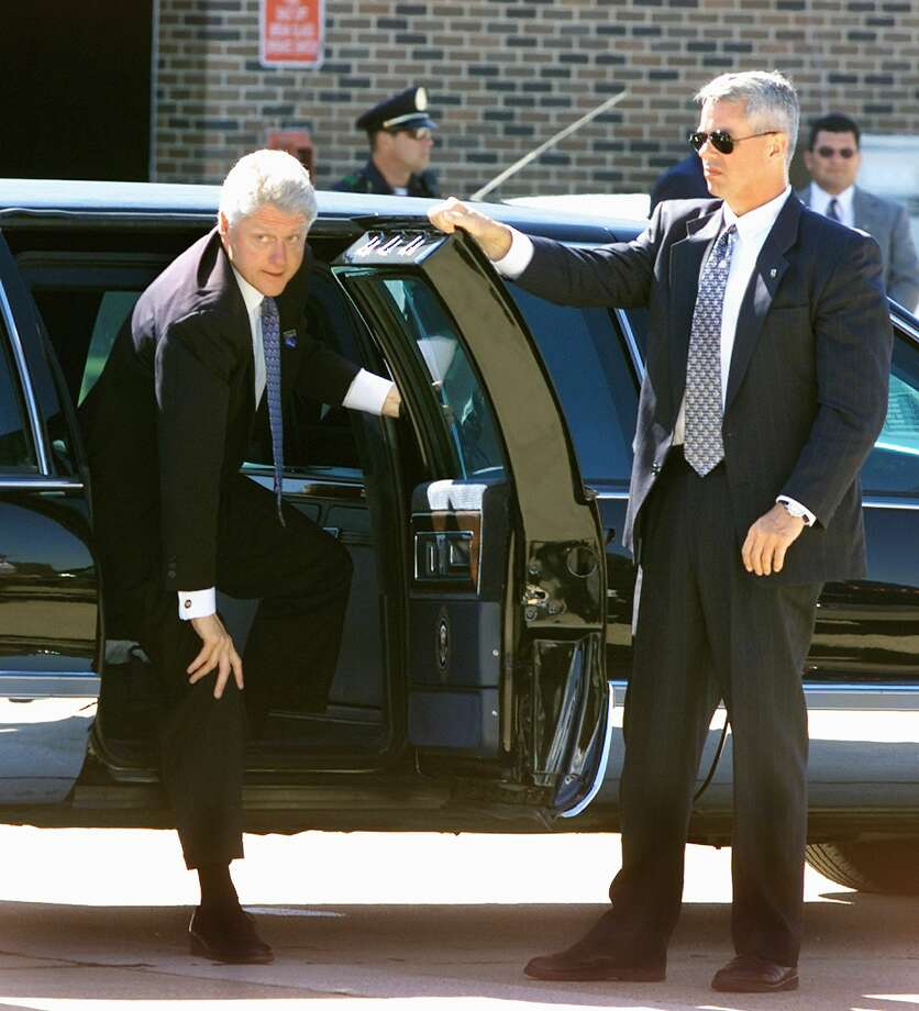 President Bill Clinton steps out of his limousine at Dallas' Love Field on Sept. 27, 2000. Photo: PAUL J. RICHARDS, AFP/Getty Images / AFP
