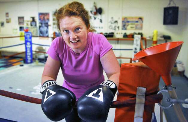 Times Union writer Leigh Hornbeck in the ring at Sweeney's Boxing gym in Delmar Thursday Feb. 14, 2013.  (John Carl D'Annibale / Times Union) Photo: John Carl D'Annibale / 00021152A