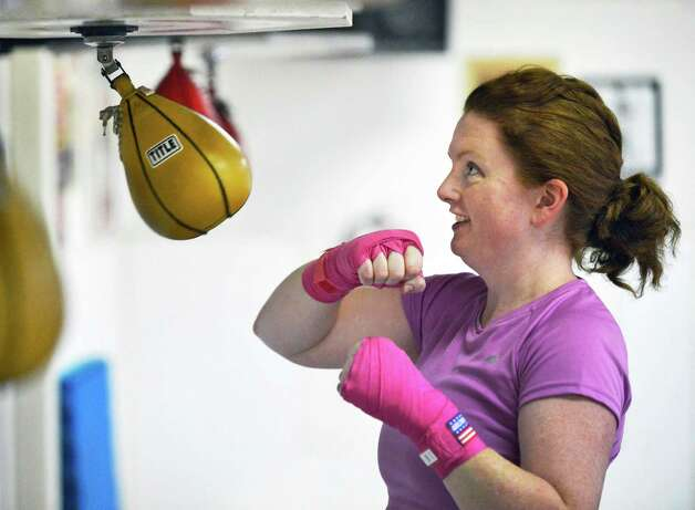 Times Union writer Leigh Hornbeck works a speed bag at Rick Sweeney's boxing gym in Delmar Thursday Feb. 14, 2013.  (John Carl D'Annibale / Times Union) Photo: John Carl D'Annibale / 00021152A