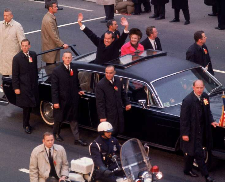 President Richard Nixon waves from his limo on the way to his inauguration on Jan. 29, 1969.
