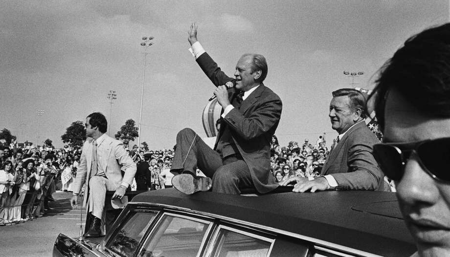 President Gerald Ford, accompanied by actor John Wayne,  addresses a crowd from atop his limousine on Oct. 24, 1976 in Fountain Valley, Calif. Photo: David Hume Kennerly, Getty Images / 2007 David Hume Kennerly