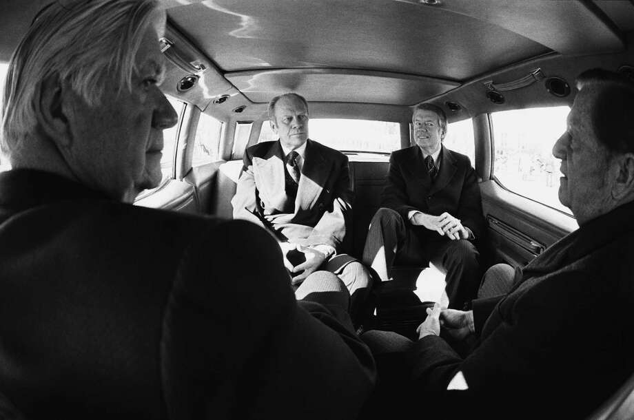 President Gerald Ford, President-elect Jimmy Carter, Sen. Howard Cannon and House Speaker Tip O'Neill  ride to the Capitol for Carter's inauguration on Jan. 20, 1977. Photo: David Hume Kennerly, Getty Images / 2007 David Hume Kennerly