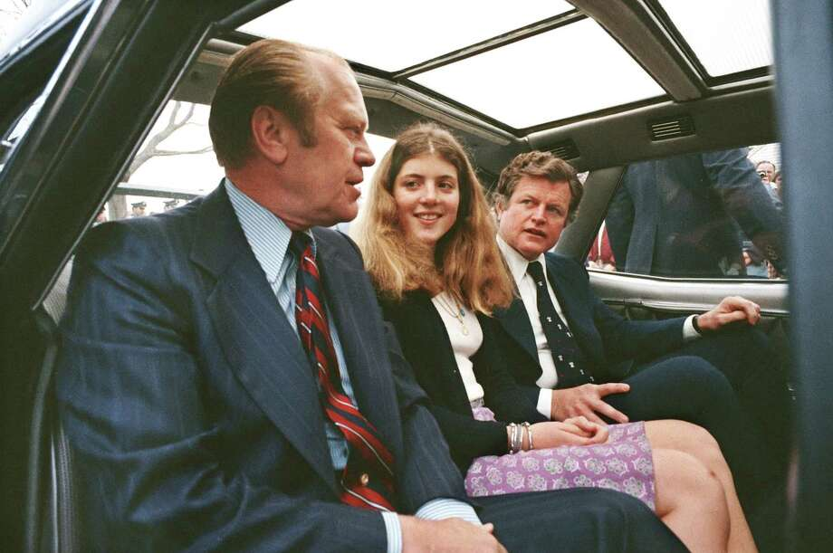 President Gerald Ford talks to Caroline Kennedy and Sen. Edward Kennedy, daughter and brother of the late President John F. Kennedy, in the back of his limousine during his visit to Lexington, Mass., on April 19, 1975, to celebrate the bicentennial of  the first battle of the Revolutionary War. Photo: David Hume Kennerly, Getty Images / David Hume Kennerly